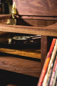 A custom turntable provided by U-Turn Audio of Boston, MA and made from the same Zebra wood as LSTN's audio products.